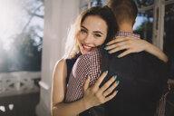 Smiling Caucasian couple hugging - BLEF03573