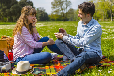Young man proposing to his girlfriend in a park - MGIF00472