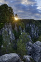 Germany, Saxony, Elbe Sandstone Mountains, Bastei area, Raaber Kessel at sunset - RUEF02191
