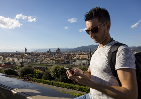 Man using his smartphone, Florence, Italy - MAUF02457