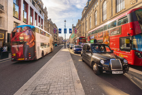 Piccadilly street by Picadilly Circus with London taxi and red bus - TAM01475