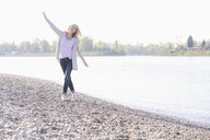 Carefree mature woman at the riverside - UUF17541