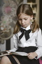 Portrait of a girl reading a book - EYAF00241