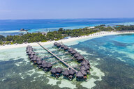 Aerial view over water bungalows at Olhuveli, South Male Atoll, Maldives - AMF07037