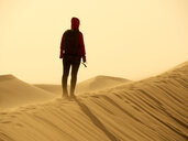 Back view of woman standing on dune in the Namib Desert, Namibia - VEGF00240