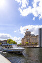 View to Reichstag with tourboat on Spree River in the foreground, Berlin, Germany - PUF01485