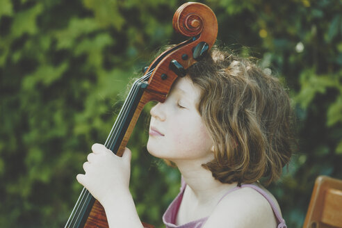 A girl taking a break during her cello exercises - IHF00022