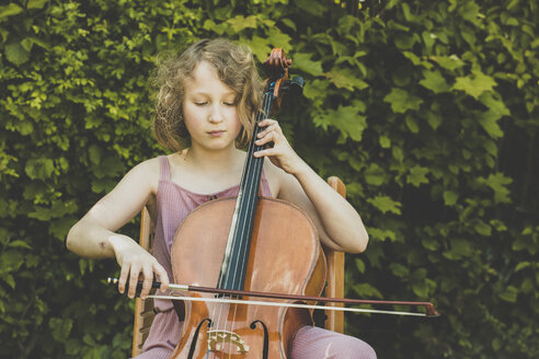 A girl playing the cello in garden - IHF00025