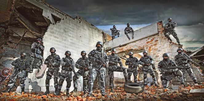Soldiers wearing masks on ruins in battlefield - BLEF03760