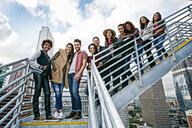Stylish friends posing on urban metal staircase - BLEF03841