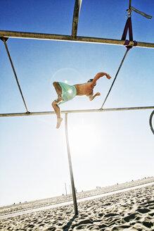 Caucasian man flipping on beach - BLEF03859