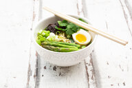 Bowl of Ramen soup with egg, green asparagus, noodles, shitake mushroom and spring onions - LVF08050