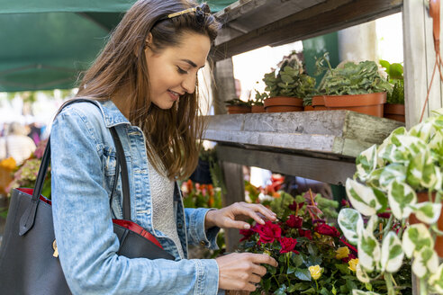 Young woman on a flower market in Barcelona - AFVF02957