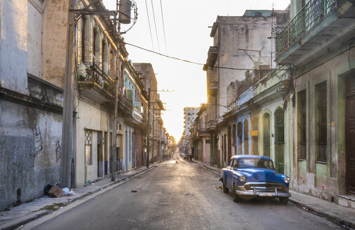 Parked blue vintage car on empty street at evening twilight, Havana, Cuba - HSIF00599