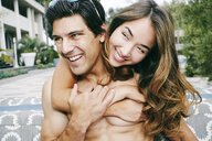 Smiling couple hugging outdoors - BLEF03934