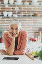 Older Caucasian woman smiling in kitchen - BLEF03976
