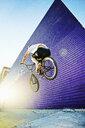 Caucasian man jumping on BMX bike - BLEF04039