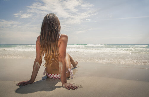 Caucasian woman sitting on beach - BLEF04063