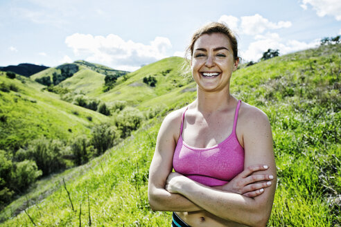 Smiling Caucasian woman posing on hill - BLEF04291
