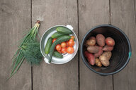 Fresh vegetables and potatoes on wooden table - BLEF04345