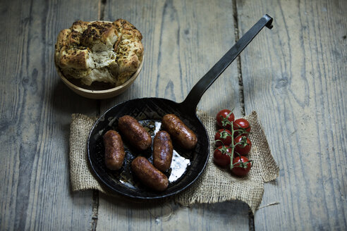 Fried Salsiccia in pan with pickled bread and compound butter - MAEF12874