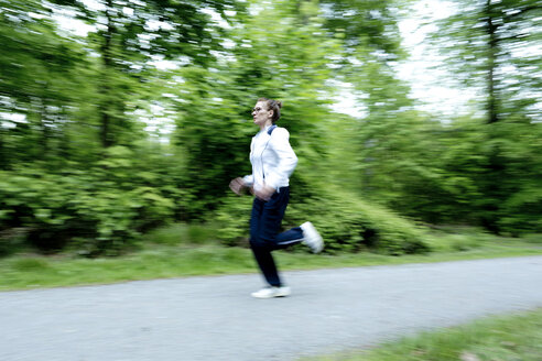 Female mature jogger in the forest - FLLF00208