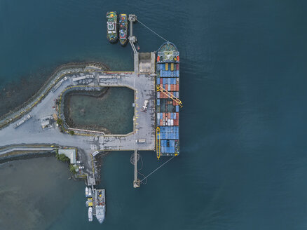 Indonesia, Sumbawa, Maluk, Aerial view of harbor, container ship from above - KNTF02779