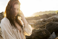 Portrait of redheaded young woman at sunset - AFVF02999