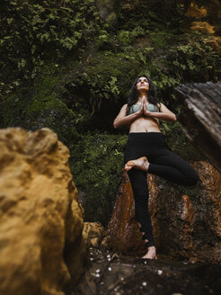 Woman practicing yoga in nature - LJF00011