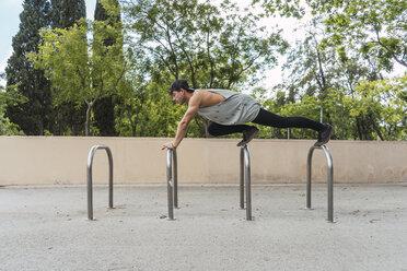 Young man doing acrobatics outdoors - AFVF03018