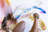 Close-up of woman painting on canvas - JPTF00071