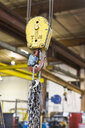 Pulley and chain hanging in factory - BLEF04478