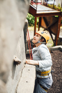 Caucasian woman climbing rock climbing wall - BLEF04592