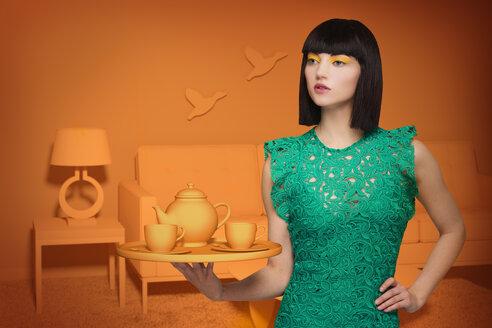 Caucasian woman in orange old-fashioned livingroom holding tea service - BLEF04761