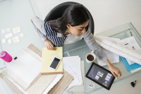 Indian businesswoman using digital tablet in office - BLEF05178