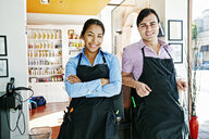 Smiling hairdressers posing in hair salon - BLEF05382