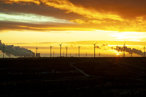 Garzweiler brown coal mining at sunrise with wind park in the background, Juechen, Germany - PUF01513