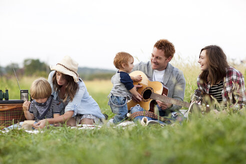 Family having picnic in rural field - BLEF05621
