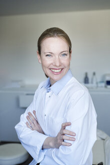 Portrait of smiling female doctor in medical practice - PNEF01511