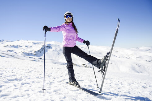 Happy woman in snow-covered landscape in Sierra Nevada, Andalusia, Spain - JSMF01109