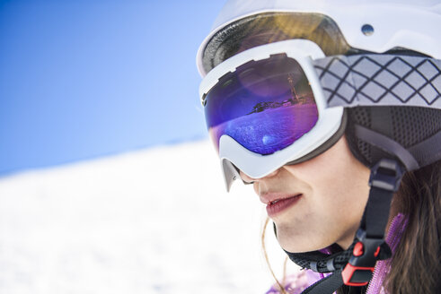 Snowy landscape reflected in ski goggles ofa woman, Sierra Nevada, Andalusia, Spain - JSMF01115