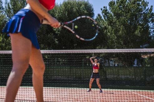 Female tennis players haying a match on court - LJF00046