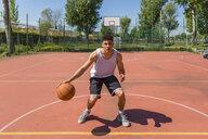 Young man playing basketball - MGIF00512