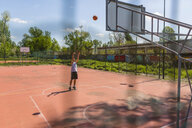 Young man playing basketball - MGIF00527
