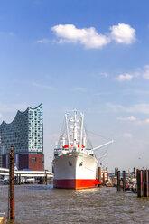 View to Elbe Philharmonic Hall with Cap San Diego ship in the foreground, Hamburg, Germany - PUF01555