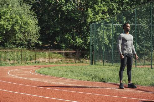 Sportsman standing on racetrack - AHSF00402