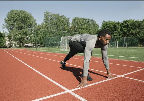 Runner on tartan track in starting position - AHSF00411