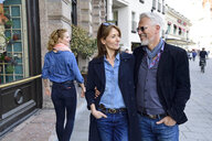 Mature couple walking in the city, man looking after an other woman - ECPF00765