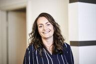 Portrait of smiling businesswoman - FMKF05700