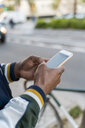Close-up of man using cell phone in the city - AFVF03166
